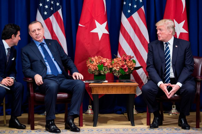 Turkish President Recep Tayyip Erdogan listens to an interpreter as U.S. President Donald Trump makes a statement at the Palace Hotel during the 72nd United Nations General Assembly in New York on Sept. 21, 2017.