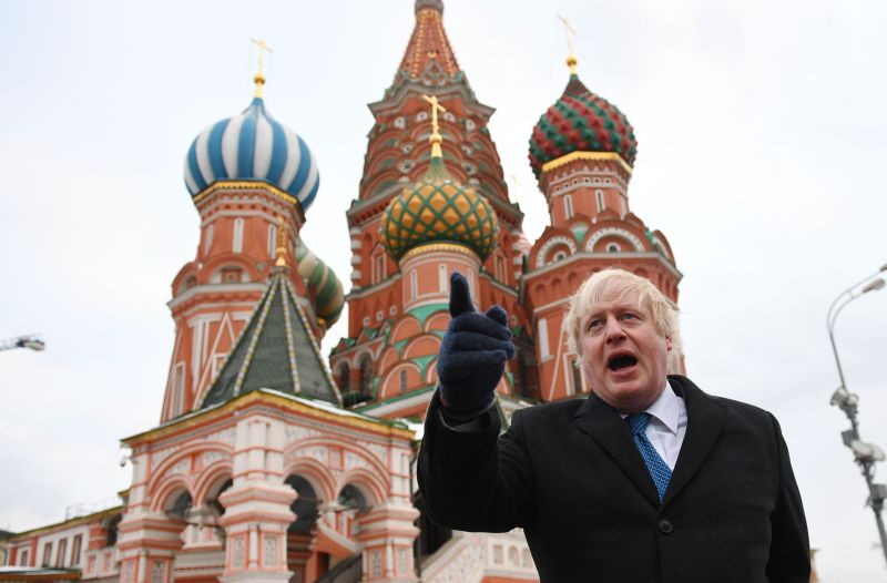 Boris Johnson stands in front of St. Basil's Cathedral during a visit to Red Square in Moscow on Dec. 22, 2017.
