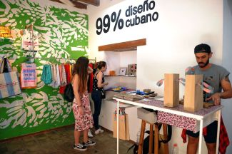 Tourists visit La Clandestina, a private shop in Havana, on March 28, 2018. Entrepreneurs known as cuentapropistas and their employees represent 12 percent of the country's work force—some 580,000 Cubans.