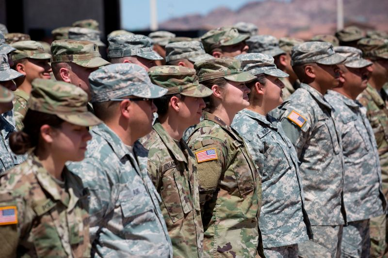 Members of the Arizona National Guard listen to instructions on April 9, 2018, at the Papago Park Military Reservation in Phoenix.