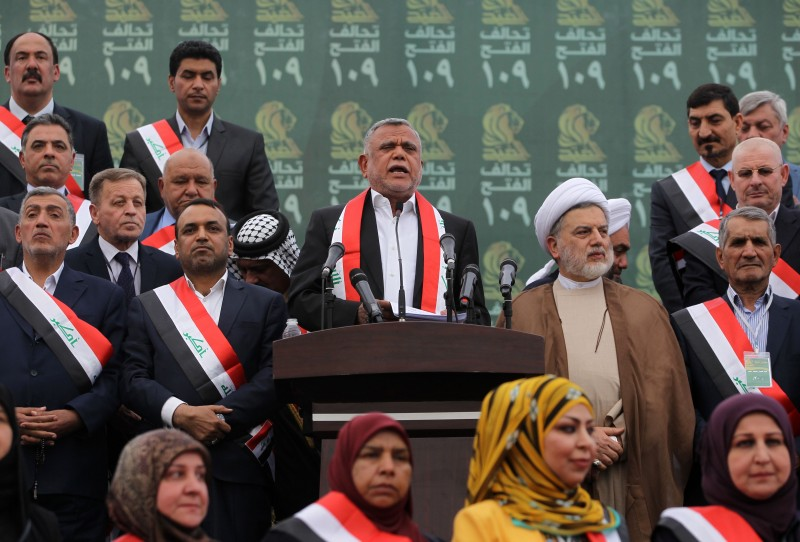 Hadi al-Amiri, head of the Iranian-backed Badr Organization and leader of the Fateh Alliance, a coalition of Iranian-supported militia groups, speaks during a campaign rally in Baghdad on May 7, 2018.