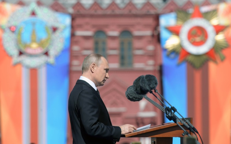 Russian President Vladimir Putin gives a speech during the Victory Day military parade at Red Square in Moscow on May 9, 2018.