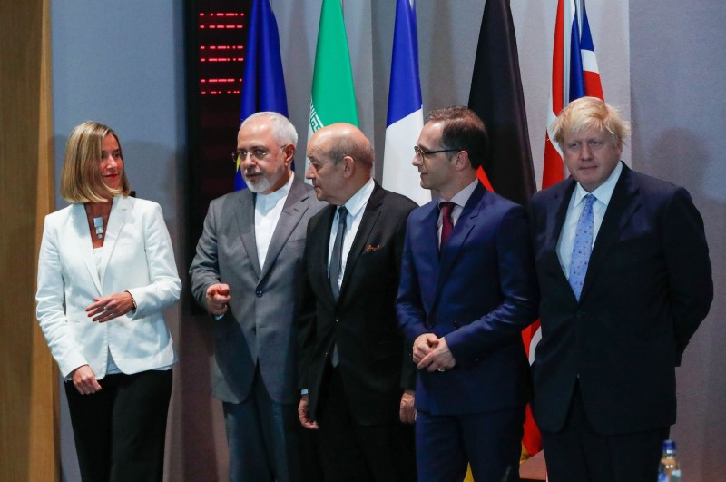 Iranian Foreign Minister Mohammad Javad Zarif, second from left, meets with top European diplomats before a meeting in Brussels on May 15, 2018.