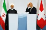 Iranian President Hassan Rouhani (left) and then-Swiss President Alain Berset hold a joint press conference in Bern, Switzerland, on July 3, 2018.