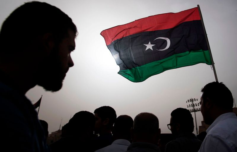 Libyans gather during the funeral of fighters loyal to the Government of National Accord in the capital of Tripoli on April 24.
