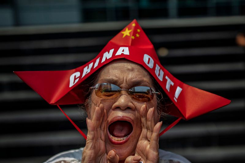 A Filipino man shouts slogans as he takes part in an anti-China protest outside the Chinese Embassy in Makati, Metro Manila, Philippines, on July 12.
