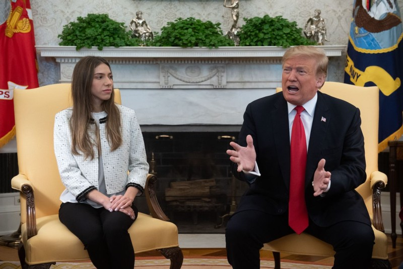U.S. President Donald Trump meets with Fabiana Rosales de Guaidó, the wife of Venezuelan opposition leader Juan Guaidó, in the White House on March 27.