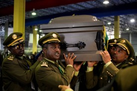 Members of the army carry a coffin covered with the Ethiopian flag in Addis Ababa on June 25, in preparation for the funeral service of the Chief of Staff of the Ethiopian National Defense Force, Seare Mekonnen, who was assassinated on June 22.