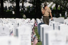 A member of the U.S. military visits Section 60 at Arlington National Cemetery in Arlington, Virginia, on May 24. Section 60 is the final resting place for U.S. soldiers killed in the United States' most recent wars, especially Iraq and Afghanistan.