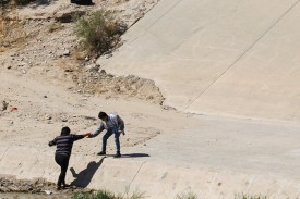 Central American migrants cross the Rio Bravo river in Ciudad Juarez, State of Chihuahua, Mexico, on July 15, 2019.