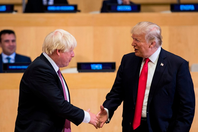 Then-British Foreign Secretary Boris Johnson, left, and U.S. President Donald Trump greet each other before a meeting at U.N. headquarters in New York on Sept. 18, 2017.
