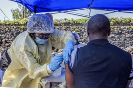 A man receives a vaccine against Ebola from a nurse outside the Afia Himbi Health Center in Goma on July 15.