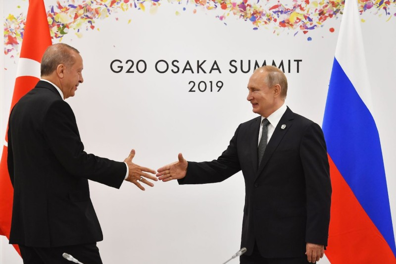 Russian President Vladimir Putin greets Turkish President Recep Tayyip Erdogan on the sidelines of the G-20 leaders summit in Osaka on June 29.
