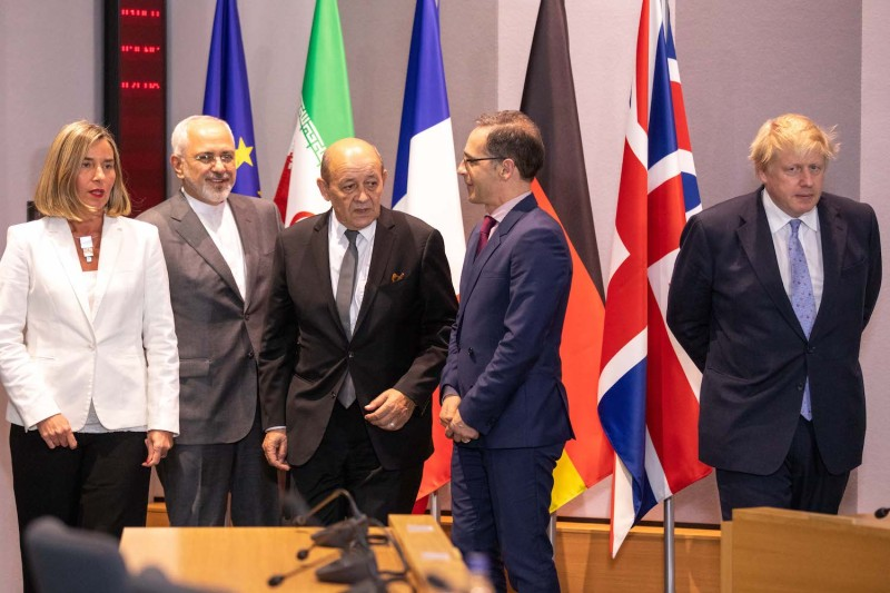 From left, EU Foreign Policy Chief Federica Mogherini, Iran's Foreign Minister Mohammad Javad Zarif, France's Foreign Minister Jean-Yves Le Drian, Germany's Foreign Minister Heiko Maas, and then-British Foreign Secretary Boris Johnson at the EU headquarters in Brussels on May 15, 2018.
