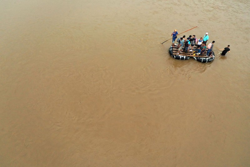 Guatemalan migrants use a makeshift raft to cross the Suchiate river from Tecun Uman in Guatemala to Ciudad Hidalgo in Chiapas State, Mexico, on July 22.
