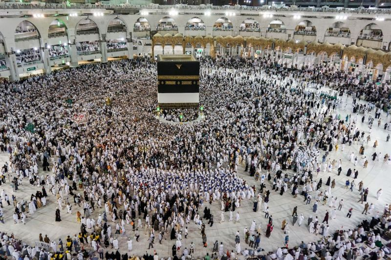 Muslim worshippers walk around the Kaaba, Islam's holiest shrine, at the Grand Mosque in Mecca on Aug. 17, 2018.