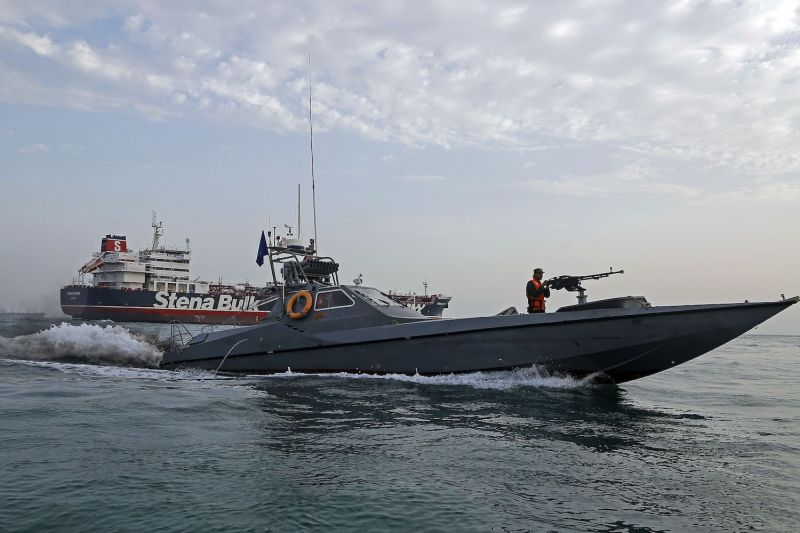 Iranian Revolutionary Guards patrol around the British-flagged tanker  Stena Impero, with 23 crew members aboard, off the port of Bandar Abbas on July 21, after they seized it in the Strait of Hormuz.