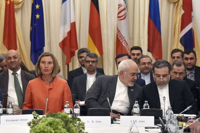 European Union High Representative for Foreign Affairs Federica Mogherini (L); Iranian Minister of Foreign Affairs Mohammad Javad Zarif (C) take part in a ministerial meeting on the Iran nuclear deal on July 6, 2018 in Vienna, Austria.