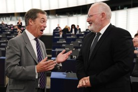 Member of the European Parliament Nigel Farage (L) speaks with European Commission First Vice-President Frans Timmermans (R) prior to a debate concerning Hungary's situation during a plenary session at the European Parliament on September 11, 2018 in Strasbourg, France.