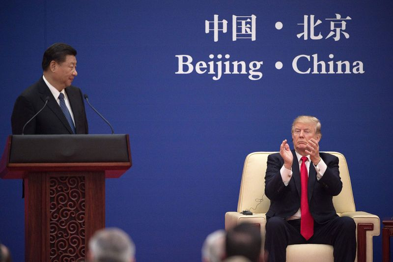U.S. President Donald Trump applauds at the end of Chinese President Xi Jinping's speech during a business leaders event in Beijing on Nov. 9, 2017.