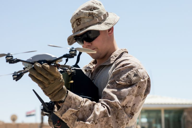 A U.S. Marine prepares to launch an InstantEye quadcopter system on Aug. 12, 2018.