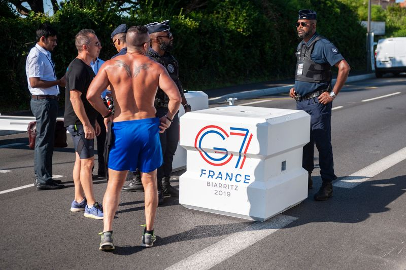 French police officers talk to passersby at the entrance to the secure zone for the annual G-7 summit in Biarritz, France, on Aug. 23.