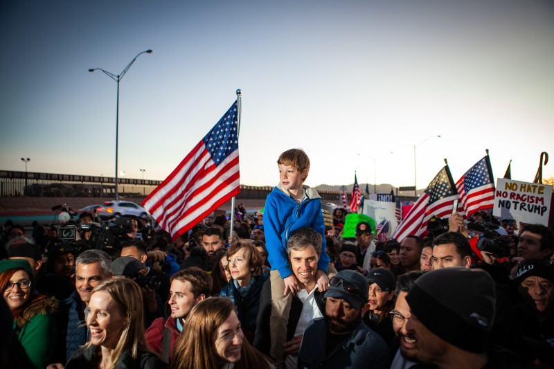 Beto O'Rourke carries his son Henry O'Rourke on his shoulder as they march along the US Mexico border in protest of President Donald Trump's proposed border wall, February 11 in El Paso, Texas.