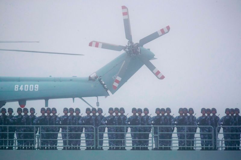 Soldiers stand on the deck of the Yimen Shan as the vessel participates in a naval parade to commemorate the 70th anniversary of the founding of China's People's Liberation Army Navy in the sea near Qingdao, in China's eastern Shandong province, on April 23.