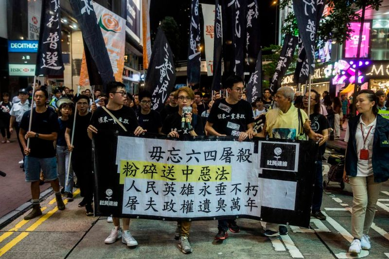 Pro-democracy activist Avery Ng and supporters march to the Hong Kong Chinese Liaison office on June 5, after a vigil to mark the 30th anniversary of the 1989 Tiananmen crackdown in Beijing.
