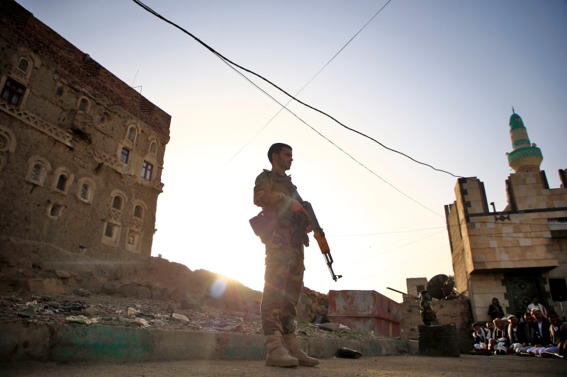 Yemeni security forces loyal to the Houthi rebel government stands guard at a square in the capital, Sanaa, on June 5.