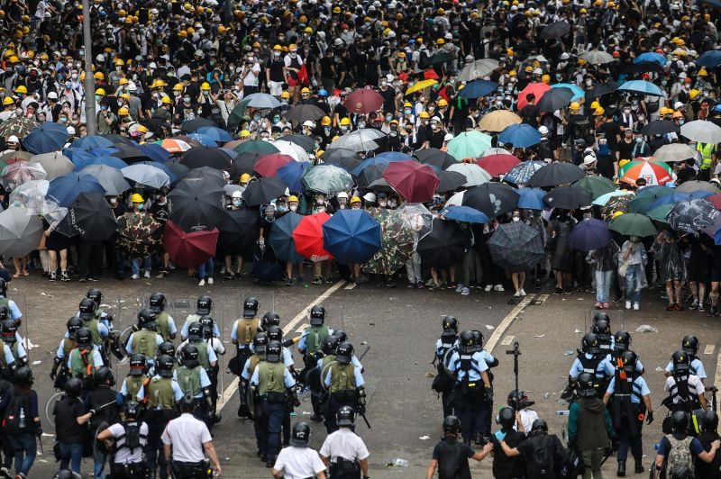 Protesters face off with police during a rally against a controversial extradition law proposal outside the government headquarters in Hong Kong on June 12, 2019.