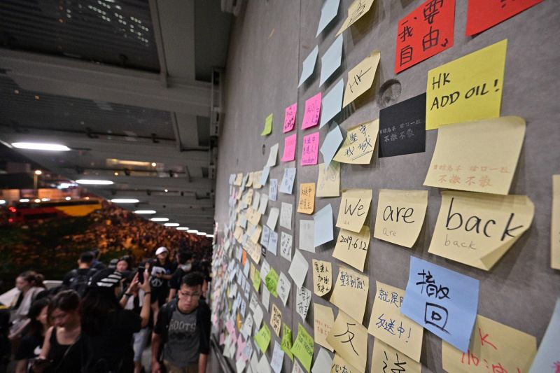 """Messages left by protesters are posted on """"the Lennon Wall"""" during a rally against a controversial extradition bill in Hong Kong on June 16, 2019."""