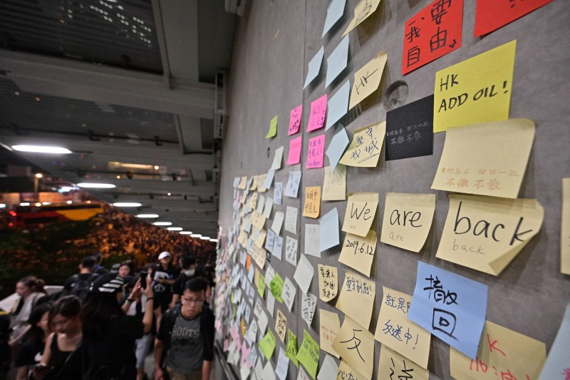 "Messages left by protesters are posted on ""the Lennon Wall"" during a rally against a controversial extradition bill in Hong Kong on June 16, 2019."