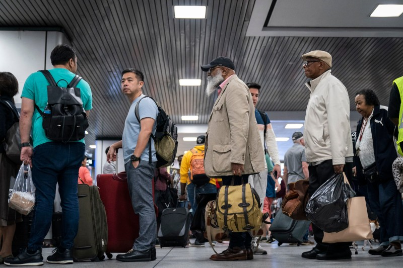 Passengers wait to board delayed Amtrak trains at New York Penn Station on June 19.