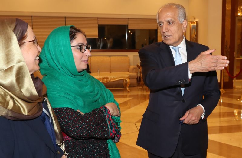 Zalmay Khalilzad, the U.S. special representative for Afghanistan reconciliation, speaks with Asila Wardak, a human rights activist, during intra-Afghan dialogue talks in Doha, Qatar, on July 8.