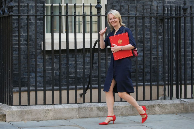 British Trade Secretary Liz Truss arrives at No. 10 Downing St. for a cabinet meeting in London on July 25.