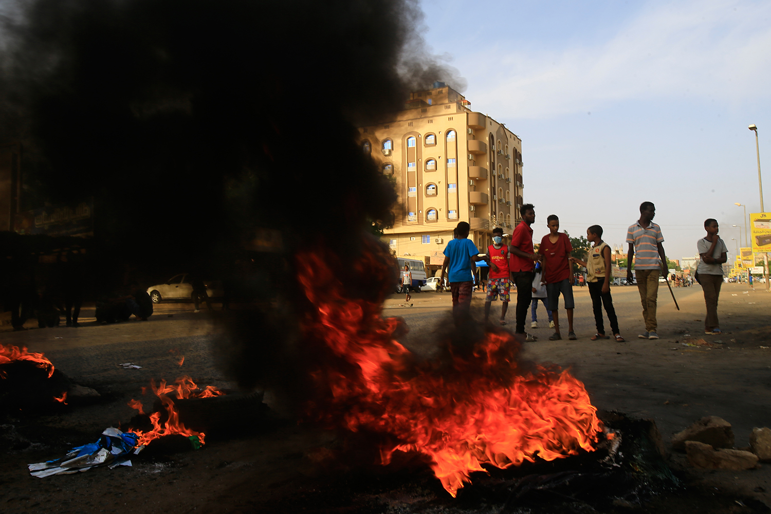 Demonstrators burn tires in the middle of a main street in Khartoum, Sudan, on July 27 as they protest the results of the probe into the June raid on a Khartoum protest camp. ASHRAF SHAZLY/AFP/Getty Images