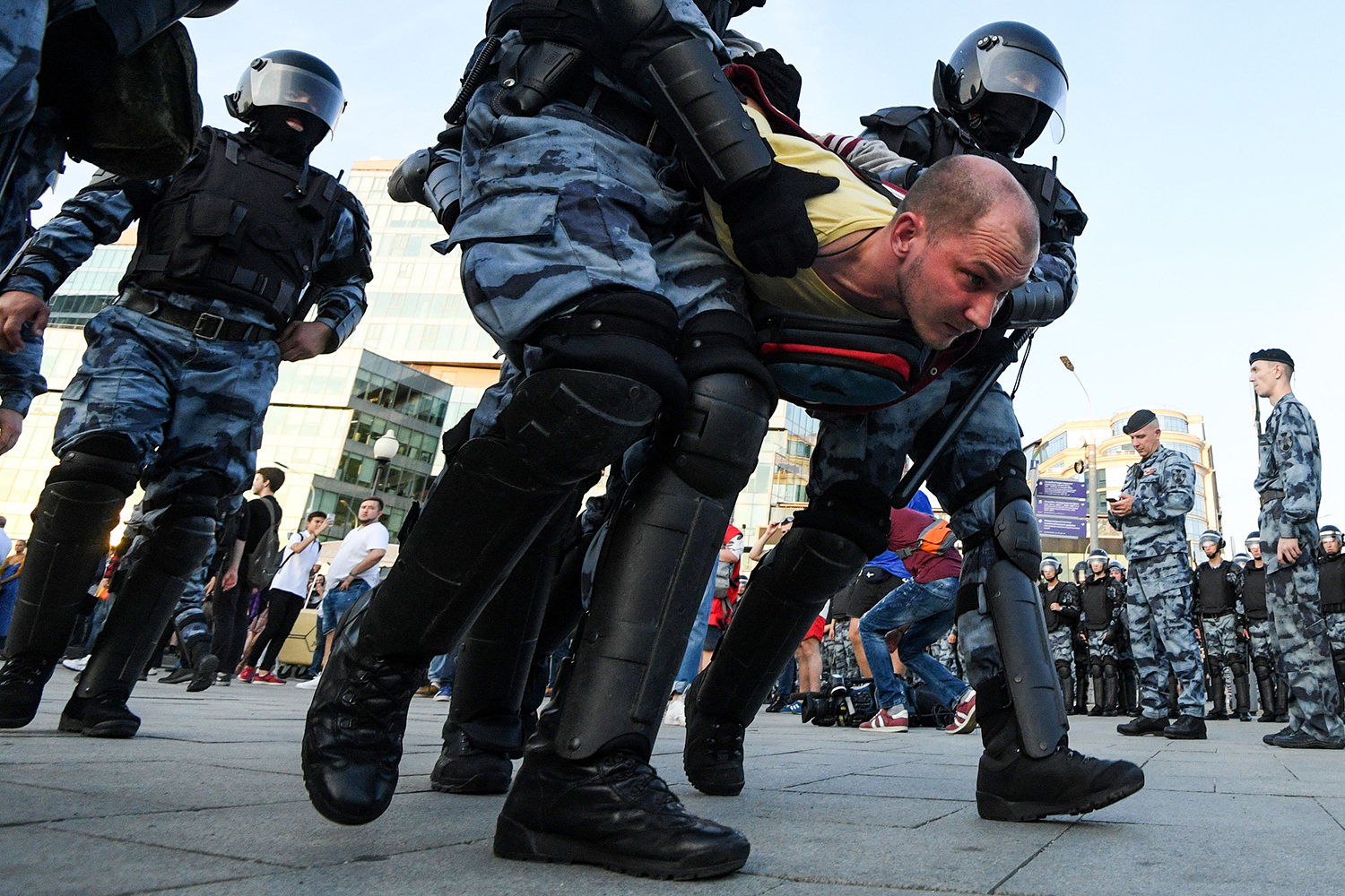 Riot police officers detain a protester during an unauthorized rally demanding that independent and opposition candidates be allowed to run for office in local elections in September, at Moscow's Trubnaya Square on July 27. KIRILL KUDRYAVTSEV/AFP/Getty Images