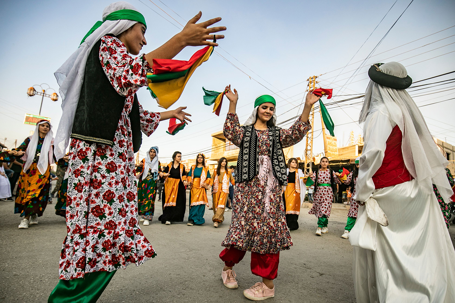 Syrian Kurds in traditional clothing dance the Dabke in a street festival in of Rumaylan in Syria's northeastern Hasakeh province on July 27. DELIL SOULEIMAN/AFP/Getty Images