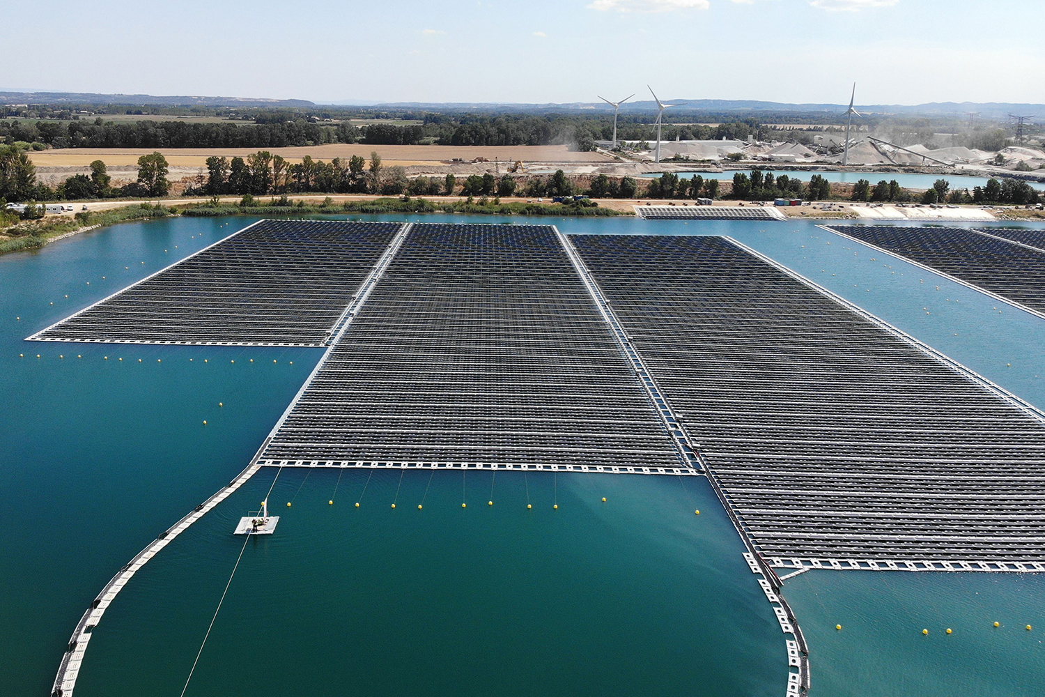Photovoltaic solar panels sweep the landscape at a floating solar-energy farm in southern France on July 30. GERARD JULIEN/AFP/Getty Images