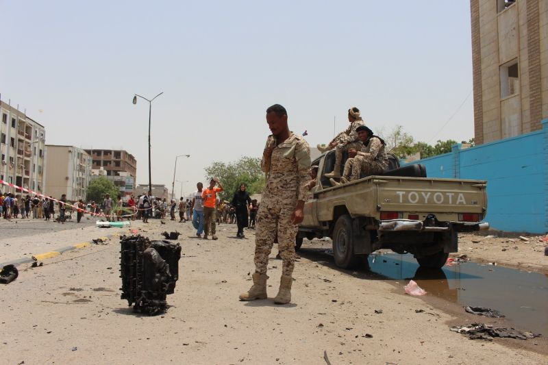 A soldier inspects debris at the site of a car bomb attack that took place at police station in Aden, Yemen, on Aug. 1.