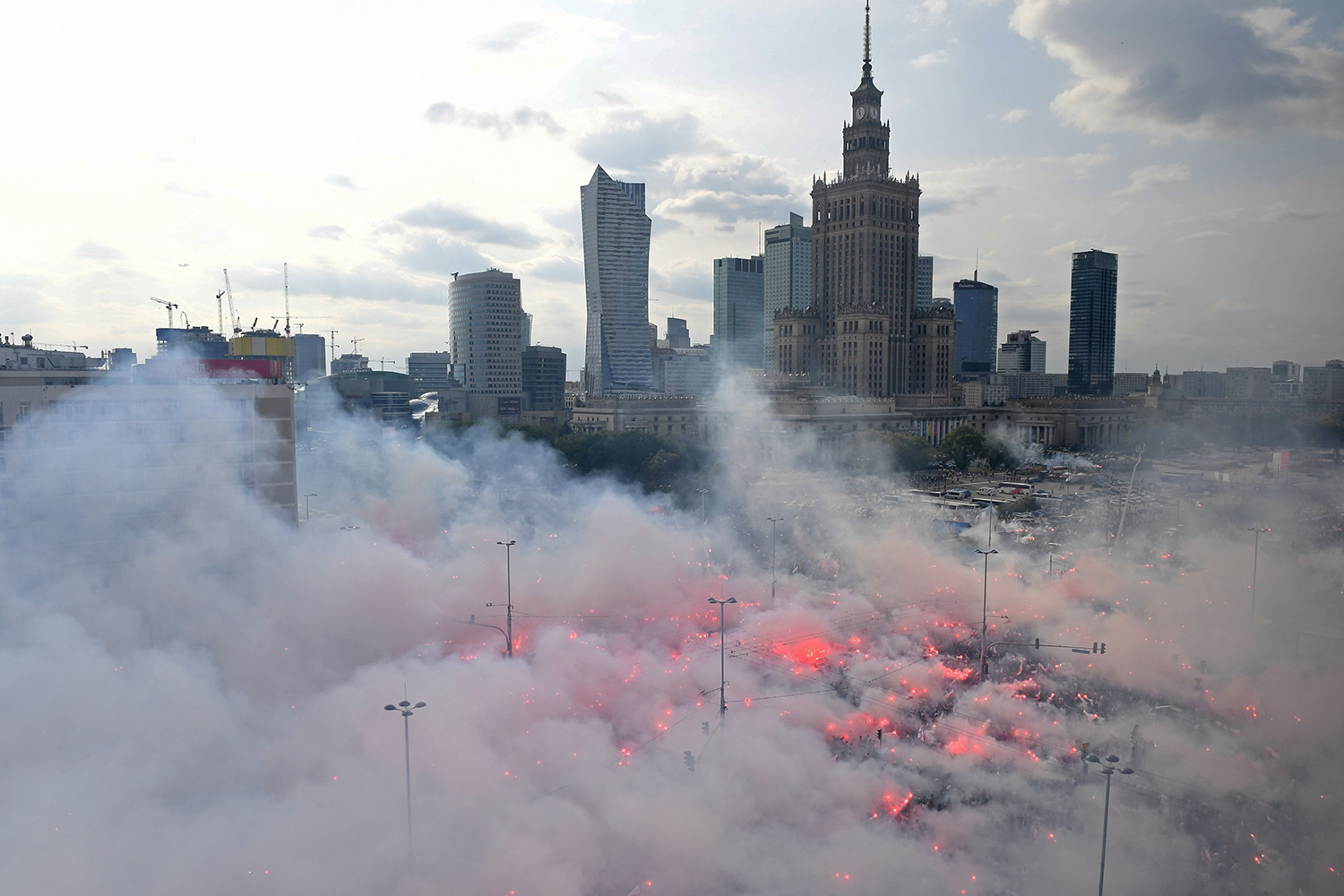 People light flares as they observe a minute of silence to mark the 75th anniversary of the Warsaw Uprising against the Nazi German occupiers during World War II in Poland on Aug. 1. JANEK SKARZYNSKI/AFP/Getty Images