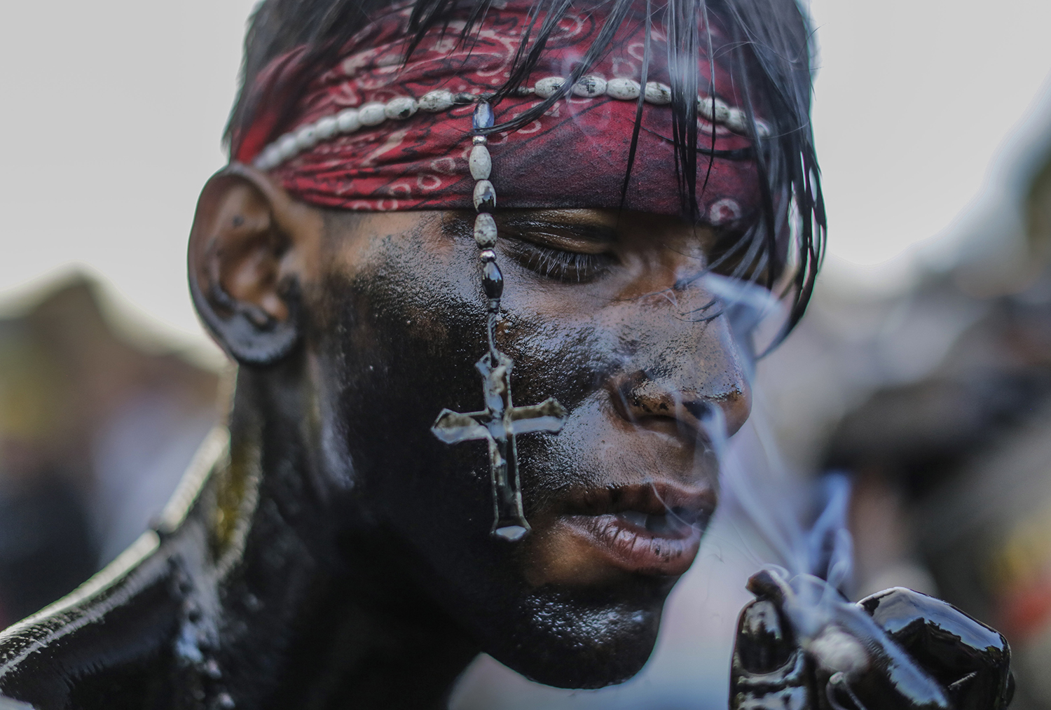 A Catholic faithful smeared in burnt oil takes part in the opening of the 10-day celebration of the Santo Domingo de Guzman festival in Managua on Aug. 1. INTI OCON/AFP/Getty Images