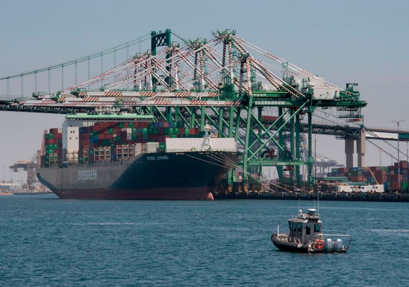 A container ship unloads its cargo from Asia at the Long Beach port in California on Aug. 1.