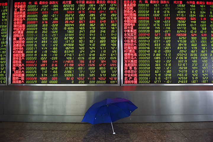 A screen showing stock prices at a securities company in Beijing on August 5.