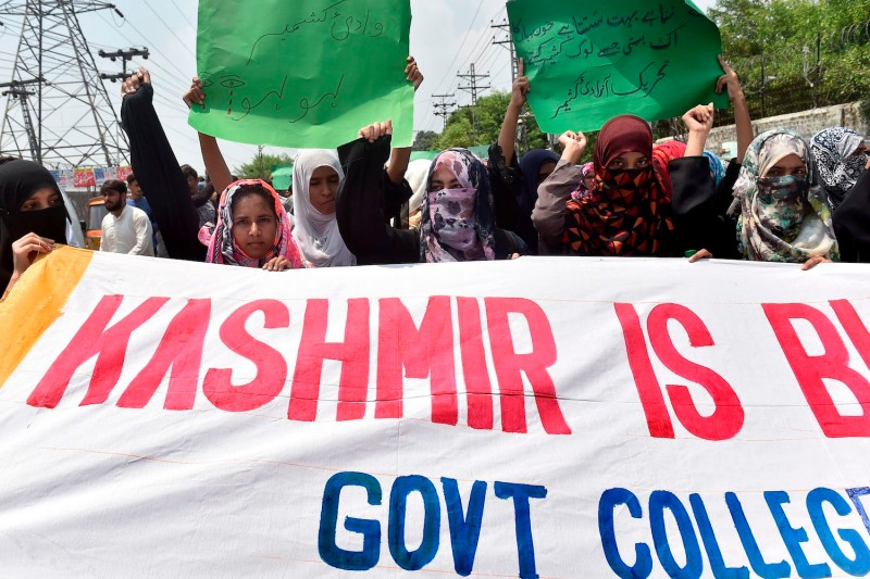 Pakistani students chant slogans during an anti-Indian protest rally in Lahore on August 5, 2019, as they denounce the ongoing unrest situation in Indian administered Kashmir.