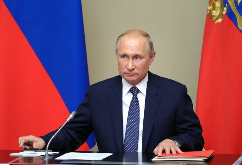 Russian President Vladimir Putin chairs a Security Council meeting at the Novo-Ogaryovo residence outside Moscow on August 5.
