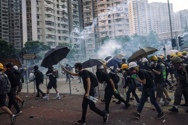 Protesters stand off against riot police at Wong Tai Sin district on August 5 in Hong Kong, China.