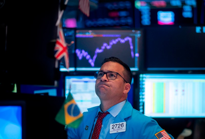 Traders react after the closing bell at the New York Stock Exchange (NYSE) on August 5.
