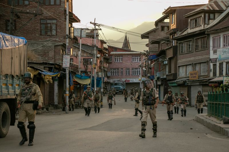 Indian security personnel walk on a street in Srinagar on August 9, 2019,